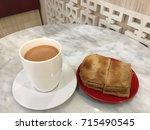 kaya toast and hot milk tea ... | Shutterstock . vector #715490545