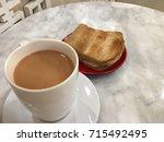 kaya toast and hot milk tea ... | Shutterstock . vector #715492495