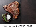 grilled t bone steak on stone... | Shutterstock . vector #715510087