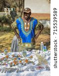 Small photo of johannesburg,South Africa - September 09 , 2017 : small business at market ,man creates beaded animals,table with his bead products,alternative income.