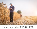 young farmer examine corn seed... | Shutterstock . vector #715541791