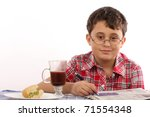 kid in glasses reading newspaper - stock photo
