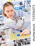 a female student or laboratory... | Shutterstock . vector #715556371