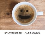 coffee with smiley face in the... | Shutterstock . vector #715560301