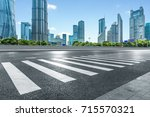 empty road with zebra crossing... | Shutterstock . vector #715570321