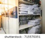 full of document paperwork... | Shutterstock . vector #715570351