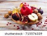 autumn harvest concept   fruits ... | Shutterstock . vector #715576339