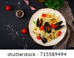 seafood fettuccine pasta with... | Shutterstock . vector #715589494