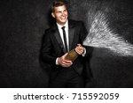 handsome man on black... | Shutterstock . vector #715592059