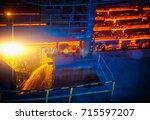 hot ingot after molten steel... | Shutterstock . vector #715597207