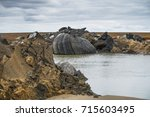 giant crater of unknown origin... | Shutterstock . vector #715603495