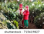 family selecting christmas tree.... | Shutterstock . vector #715619827