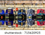 rows of houseboats and narrow...