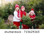 family selecting christmas tree.... | Shutterstock . vector #715629265
