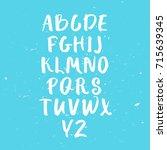 calligraphic font. handwritten...   Shutterstock .eps vector #715639345
