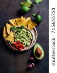 guacamole and nachos on the... | Shutterstock . vector #715655731
