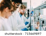 group of chemistry students... | Shutterstock . vector #715669897