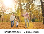 mother and father playing with... | Shutterstock . vector #715686001
