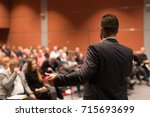 speaker giving a talk on... | Shutterstock . vector #715693699