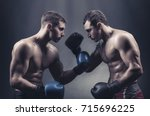 two boxers in boxing gloves met ... | Shutterstock . vector #715696225