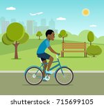 man afro american riding a... | Shutterstock .eps vector #715699105