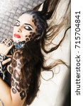 young sexy woman with leopard... | Shutterstock . vector #715704841