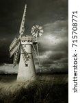 Windmill In A Field By Moonlight