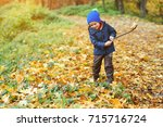 cute happy boy playing with... | Shutterstock . vector #715716724
