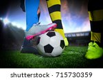 soccer player with ball in... | Shutterstock . vector #715730359