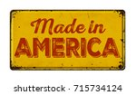 vintage rusty metal sign on a... | Shutterstock . vector #715734124