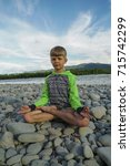 peaceful boy meditating in a... | Shutterstock . vector #715742299