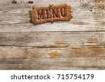 retro style menu sign nailed on ... | Shutterstock . vector #715754179