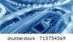 overpass of the light trails ... | Shutterstock . vector #715754569