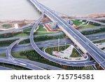 city highway interchange in... | Shutterstock . vector #715754581