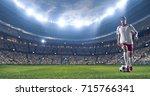 soccer player kicks the ball on ... | Shutterstock . vector #715766341