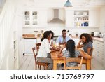 family with teenage children... | Shutterstock . vector #715769797