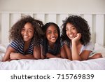 portrait of three teenage... | Shutterstock . vector #715769839