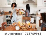 three teenage girls clearing... | Shutterstock . vector #715769965