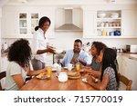 family with teenage children... | Shutterstock . vector #715770019