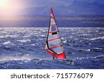 sportman windsurfer on the lake ... | Shutterstock . vector #715776079