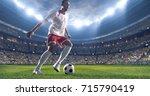 soccer player kicks the ball on ... | Shutterstock . vector #715790419