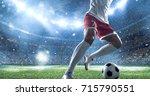 soccer player kicks the ball on ... | Shutterstock . vector #715790551