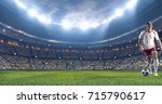 soccer player kicks the ball on ... | Shutterstock . vector #715790617