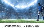 soccer player kicks the ball on ... | Shutterstock . vector #715809109