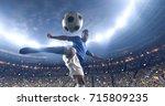 soccer player kicks the ball on ... | Shutterstock . vector #715809235
