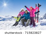 laughing family in winter... | Shutterstock . vector #715823827
