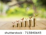 growing plant on row of coin... | Shutterstock . vector #715840645