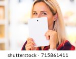 young attractive woman hides... | Shutterstock . vector #715861411
