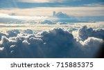 cloud from plane window view. | Shutterstock . vector #715885375