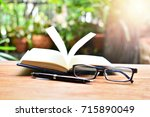 open book on table for concept...   Shutterstock . vector #715890049
